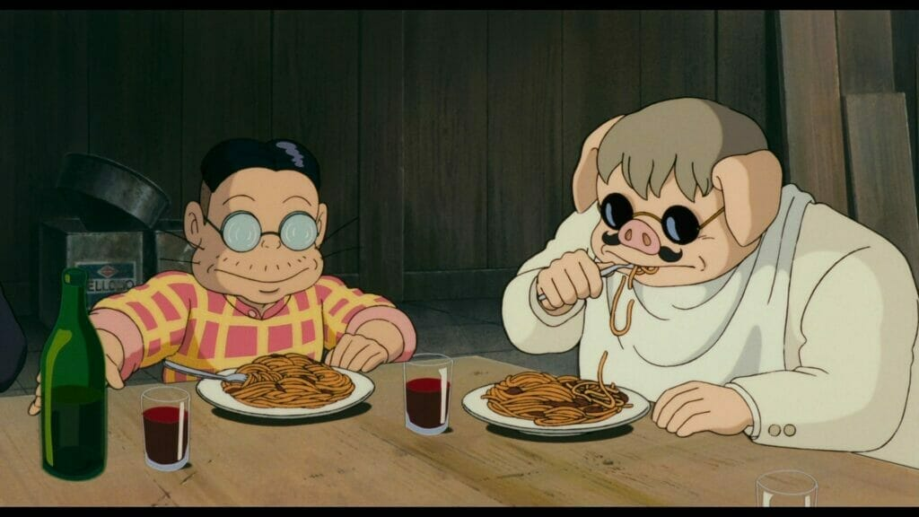Still from Porco Rosso that depicts a pig-headed man eating pasta next to a short man wearing thick glasses.