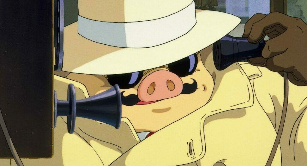 Still from Porco Rosso that depicts a man in a fedora and yellow coat, with a pig head, talking on a pay phone.