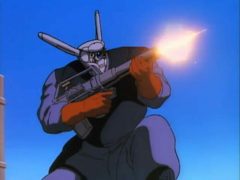 A giant robot crouches as it fires a rifle offscreen.