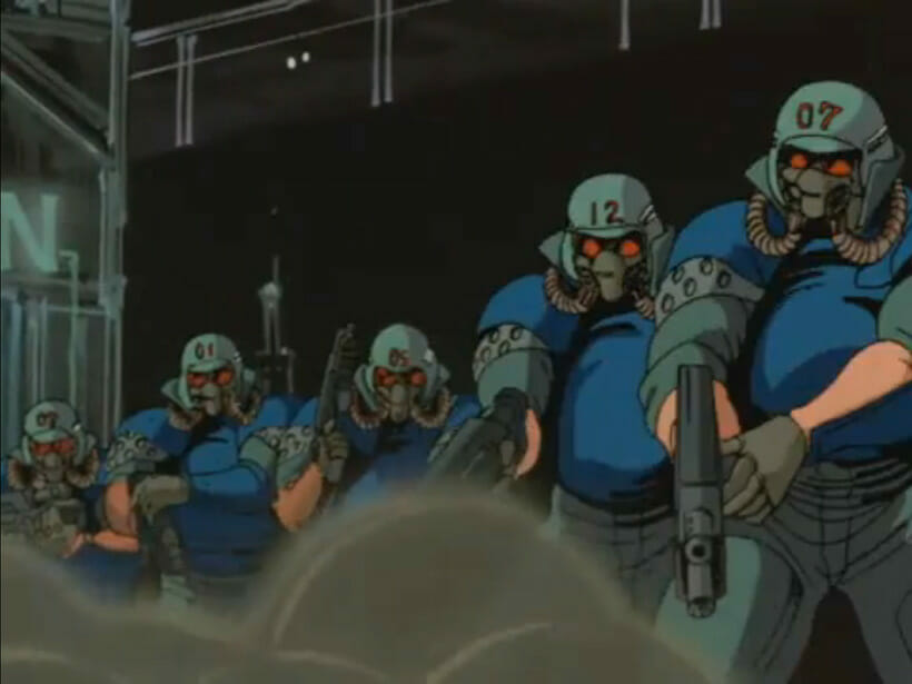 Several masked soldiers rush through an exploded building, their weapons drawn.