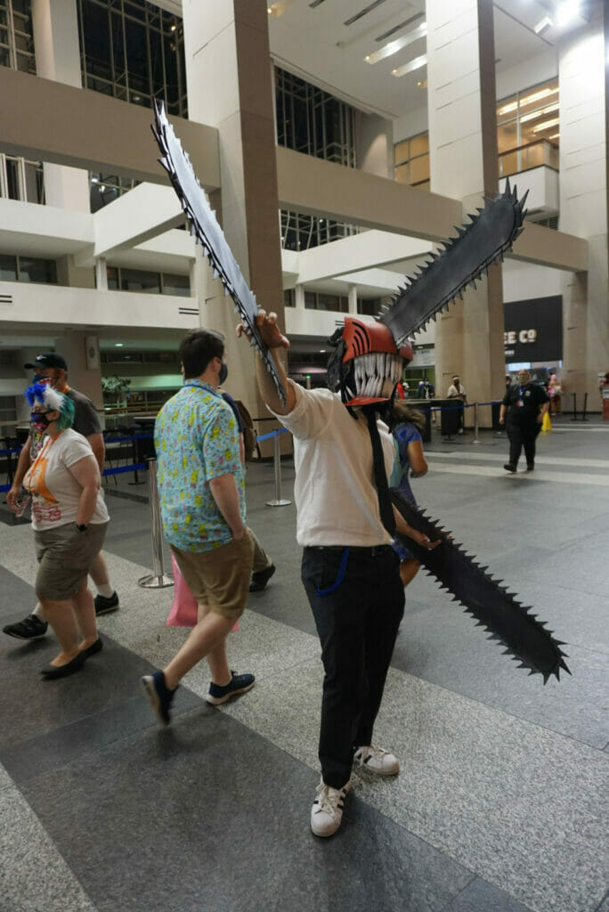 Photo from Otakon 2021 - A man dressed as the lead character of Chainsaw Man poses for the camera